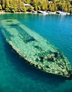 One of the most popular shipwreck – the remains of the Canadian schooner Sweepstakes - lies in Lake Huron. Sweepstakes is located approximately 50 yards from the head of Big Tub Harbour in only 20 feet of water. Michigan Travel, Lake Michigan, Munising Michigan, Travel Oklahoma, Westminster, Great Lakes Shipwrecks, Great Lakes Ships, Abandoned Ships, Lake Huron