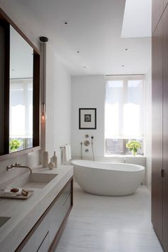Bright Bathroom Interior With Clean White Wall Paint And Completed With White Freestanding Bathtub And Astounding Vanity Plus Gorgeous Large Mirror Bad Inspiration, Bathroom Inspiration, Bathroom Ideas, Asian Bathroom, Bathroom Photos, Bathroom Trends, Modern Bathroom Design, Bathroom Interior Design, Bathroom Designs