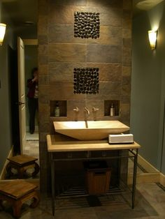 love the slate mixed with the river rock and the niches but do not like the side by side mirror...need some sort of mirror above the sink