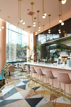 Cafeteria, Tel Aviv by Meir Guri. Dusty pink, blue velvet and multiple coloured marble flooring tiles with bar area of restaurant