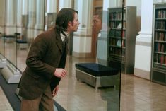 The Time Machine (2002) which stars a librarian time traveler.  Cool.