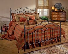 The Oklahoma bed combines grace and flair. The gently flowing design invokes the imagery of the wind sweeping over the prairie, while the spindled grill and tear drop finials show traditional style. Bronze finish.Fully-welded tubular construction.    Available as a Bed (Headboard and Footboard) in Full, Queen and King size; or Headboard only in Full/Queen size.    Headboard height of 54 inches and Footboard height of 35 inches.  Frame required.