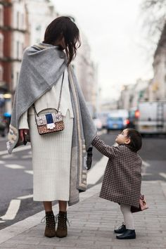 Fashionable mother enroute to paris fashion week with her young daughter