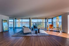 Frameless sliding doors from Sky-Frame are the key to an unbounded spatial experience with spectacular vistas. Sliding Doors, Switzerland, Beach House, Conference Room, Table, Furniture, Home Decor, Architects, Beach Homes