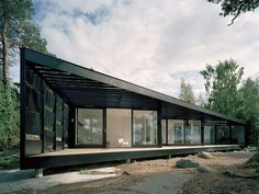 Summerhouse in the Stockholm Archipelago by  Tham & Videgård