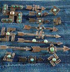 Fred Harvey era whirling log pins.