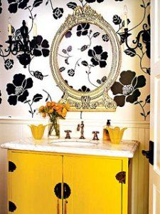 Love the flower print and yellow sink cabinets