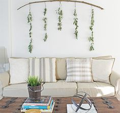 How to make a large scale wall decor that only costs a few dollars using a branch and seeded eucalyptus!