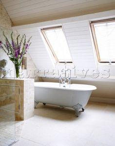Freestanding rolltop bath below windows of attic conversion Oxfordshire England UK Attic Bathroom, Bathrooms, Attic Conversion, Loft Ideas, Interior Photography, England Uk, Clawfoot Bathtub, Interior Ideas, Master Bath
