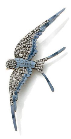 Antique swallow brooch in silver, vermeil, enamel, diamond, and ruby brooch, circa 1900