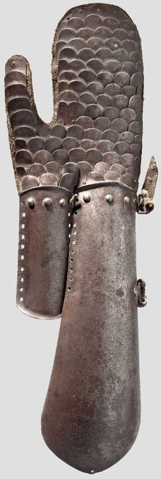 Polish hussar vambrace (arm guard) in the Indo-Persian bazu band style, 17th/ 18th century, formed in one piece, each with two strap loops on the outside. Both vambrace and wrist guards have numerous fastening holes on the insides. There are gauntlets riveted to the lower ends with scale armor densely riveted to the leather. Length 51 cm.