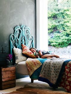 gorgeous turquoise headboard. love this bed / bedroom design!!