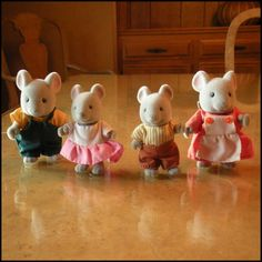 I had THESE!  Vintage Toy Maple Town Family The Mouse Family. $18.00, via Etsy.
