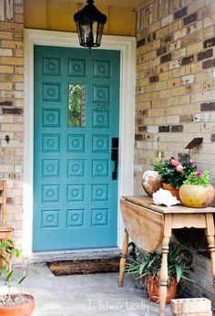 Teal front door.
