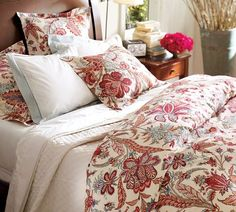 My sister-in-law has this duvet cover with red bed sheets... I was thinking same cover with white bed sheets and a red tufted headboard