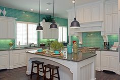 Kitchen, aqua, white cabinets, dark wood floors.