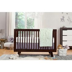 The Tranquil Woods 5-Piece Set combines modern nursery essentials for baby's comfort.  A fitted crib sheet featuring the miniature flora and fauna of a woodland landscape is paired with a tailored, fog grey crib skirt.  The imaginative play blanket is perfectly padded for active play, and the contour changing pad cover is topped with a luxurious French terry cloth that is soft to baby's touch and easy-to-clean.  To complete your scenic nursery, playfully arrange easy to apply decals across…