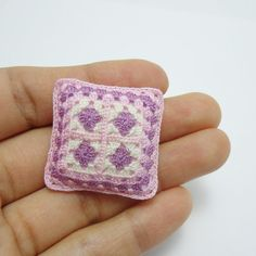 One miniature crochet pillow for dollhouse in granny square design, front in pink, purple and cream, the back of the pillow is pink. Stuffed with fluffy soft fill in a pale pink cotton case. It measures 3.0 x 3.0 cm (1 1/4 x 1 1/4). Handmade crocheted by me with cotton sewing thread. See more pillows in www.etsy.com/shop/MiniGio?section_id=15491692 You only pay shipping for the first item in your order, any additional item ships for free in the same order. For...