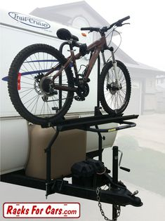Arvika 2 bike rack on travel trailer with bike loaded, left view