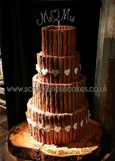 www.scrumptiouscakes.co.uk (1095) - 4 tier chocolate flake wedding cake with Mr & Mrs topper and white heart bunting.