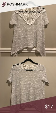 Francesca Sweater with Lace Detail This short sleeve thin sweater top with lace detail in the back is perfect with a pair of jeans! Only worn once. Francesca's Collections Tops