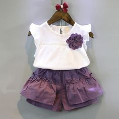 Cheap clothing sets, Buy Quality shorts clothing directly from China children girls Suppliers: summer Style children Girls fashion short sleeve flower chiffon T-shirt + purple pleated shorts clothing set Baby Girl Dresses, Baby Dress, Little Girl Fashion, Kids Fashion, Short Outfits, Kids Outfits, Kids Dress Wear, Pleated Shorts, Outfit Sets