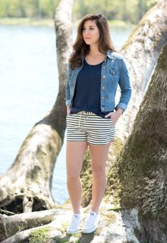 Striped shorts with a navy tank top and jean jacket.