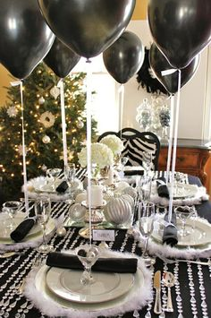 New Year's Eve party tablescape with black baloons tied to napkins #newyearseve