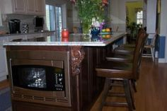 custom island in cherry square raised panel doors, Chestnut stain by Oceanside Cabinets