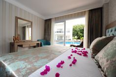 Delita Boutique Hotel offers 20 luxurious suites surrounded by gardens and all just steps from the magnificent central swimming pool.50m2 Suite comprising bedroom, bathroom and sitting room with outdoor terrace/balcony.