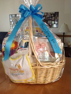 Great idea for the grandmother at a baby shower. When a baby is born, so is a grandmother. Give all the little baby things she might need at her home: toddler cups, baby spoons, wipes, books, grandma frame, grandma bib....