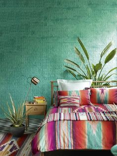 Inspired by the hot colours and exuberant patterns of South America, this bedroom decorating look is both vibrant and uplifting. Tip: Mix and match contrasting bold hues to create the look. Copper, still a big trend this year, will also work well with these hot colours. (Photo: Marks & Spencer). Find more inspiration at http://housebeautiful.co.uk