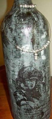 This empty wine bottle is all dressed up with some tissue paper and silver beads.