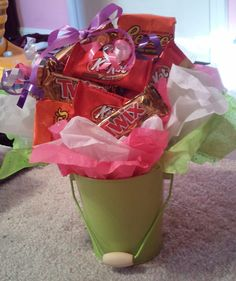 Another one of my crafts. A little Mother's Day present for my boyfriend's mom. I grabbed a mini bucket from the dollar bin at Target filled it with tissue paper and ribbon. There's a box of Raisinets in the back and the remaining candy is hotglued to either the Raisinets or popsicle sticks in the bucket. The whole gift was right at 5 bucks. Just need to add the card!