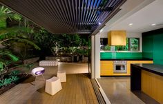 green tropical kitchen, open plan by Sydney based architects Nobbs Radford