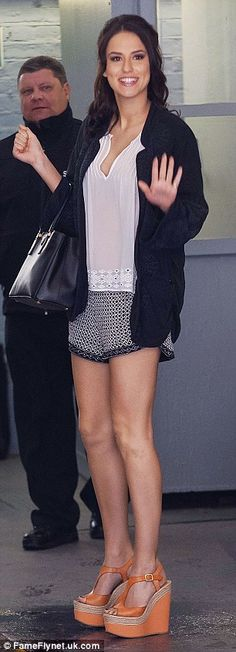 Binky Felstead: The dark haired star showed off her long legs as she arrived wearing shorts and wedged-shoes