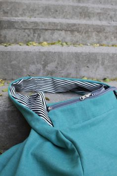 green/white blue striped bag. Double sided with zipper.