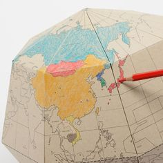Beautifully formed paper globe that you can colour in (by drill design)