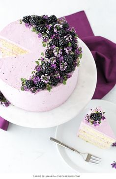 Blackberry Lime Cake - tender cake infused with lime zest, frosted with blackberry buttercream, topped with fresh blackberries and edible flowers.
