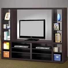 Coaster Furniture Entertainment Wall Unit with Open Shelves. Crafted of solid wood with veneers. Merlot finish. 16 Adjustable open shelves. Maximum TV Size: 70 in. Maximum TV weight: 80 lbs.