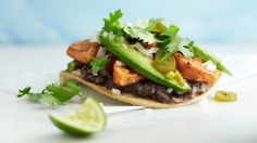 Sweet potatoes roasted with chili powder are an excellent pairing with black beans in this easy and healthy tostada recipe.
