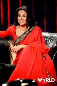 Bollywood actress Vidya Balan in red color designer saree with contrasting green, blue and gold tricolor border work paired with quarter sleeves saree blouse with wide neck pattern from designer Sabyasachi. Kareena Kapoor Saree, Manish Malhotra Saree, Sabyasachi Sarees, Bollywood Saree, Bollywood Fashion, Bollywood Actress, Indian Bridal Sarees, Crepe Saree, Saree Trends