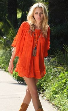 I wouldn't wear this as a dress, but as a shirt. LIke the bright color, the flounciness.  The long necklace, loose hair. AML. Orange boho chic #orange