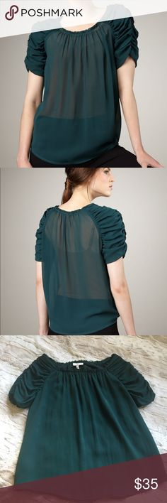"""{Joie} Ruched Silk Blouse Gorgeous emerald green ruched top. Flowy and feminine. This shirt has it's share of blemishes: The top left hem at the chest was recently taken to seamstress who put a poorly matched thread in the repair. A few small stains, and the back neck hem has come un-done. All this being said, this top is lovely and I always get compliments on it. Could fit a small.   Approximate Measurements: -Bust: 20"""" -Length: 24"""" at it's longest (rounded hem)  Bundle to Save! 3+items=30%…"""