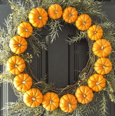Make this Circle Pumpkin Wreath in less than 30 minutes. All you need is wire, pumpkins and (of course) a wreath!.