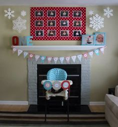"Winter ONEderland first birthday mantle decorations: cardboard wrapped in fabric with 12 month pics displayed (held up with command adhesive), snowflakes from Amazon thumb-tacked to ceiling, dollar store picture frames spray painted teal, ONE cardboard letters from JoAnn Fabrics (also spray painted), DIY happy birthday banner and ""I am one"" pennant, sewed a high chair cover."