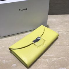632532242cb2 Celine Trotteur Large Flap Multifunction Wallet In Grained Calfskin Yellow  2017 Celine Bag