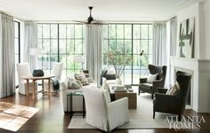 A new addition, the family room was designed with a young family in mind. Chairs, Scout for the Home. Basket, pillows, table lamp and Carrie Penley painting, B.D. Jeffries. Armchair throw, Holland & Sherry. Iron-and-glass table, Noah J.