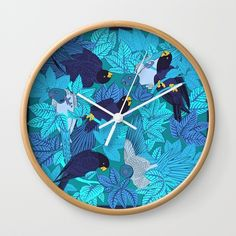 """Available in natural wood, black or white frames, our 10"""" diameter unique Wall Clocks feature a high-impact plexiglass crystal face and a backside hook for easy hanging. Choose black or white hands to match your wall clock frame and art design choice. Clock sits 1.75"""" deep and requires 1 AA battery (not included)."""