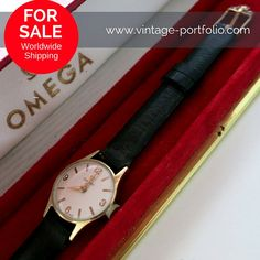 Omega watch in full gold with original ribbon and box. € 650.00  Description:  - Original Omega ladies watch hand-wound - 14 carat gold 585 housing (Full Gold hallmarking available) - Email-colored dial with golden indexes (perfect condition) - Diameter: ca 20 mm (measured without crown) - Year: 1960 - Black leather strap Original Omega Real - Original Omega Buckle